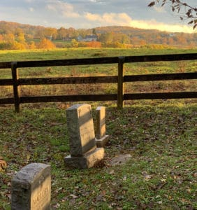 Head stones at sunset overlooking Waterford farmland